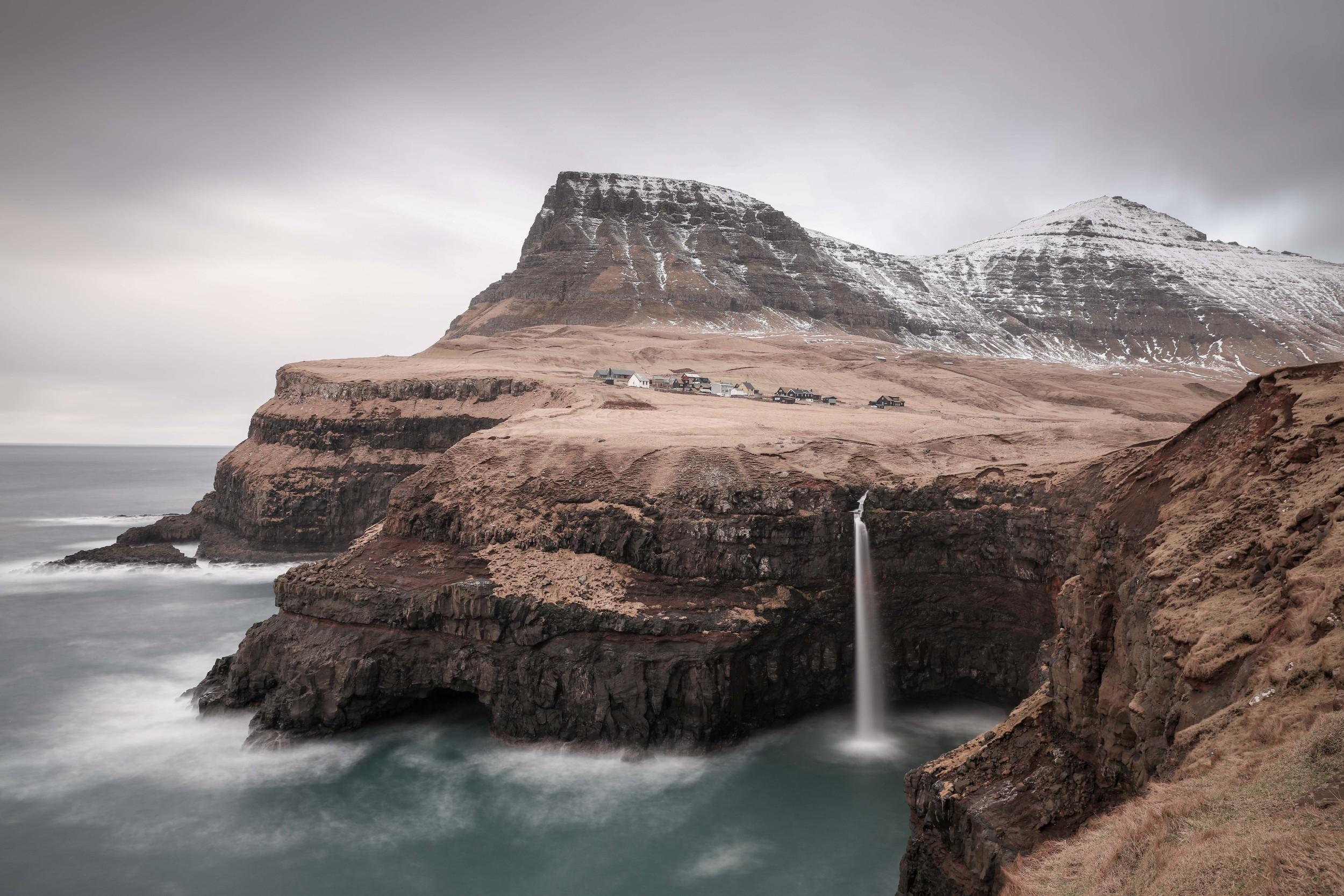 Gasadalur waterfall in Faroe Island appears to flow upwards
