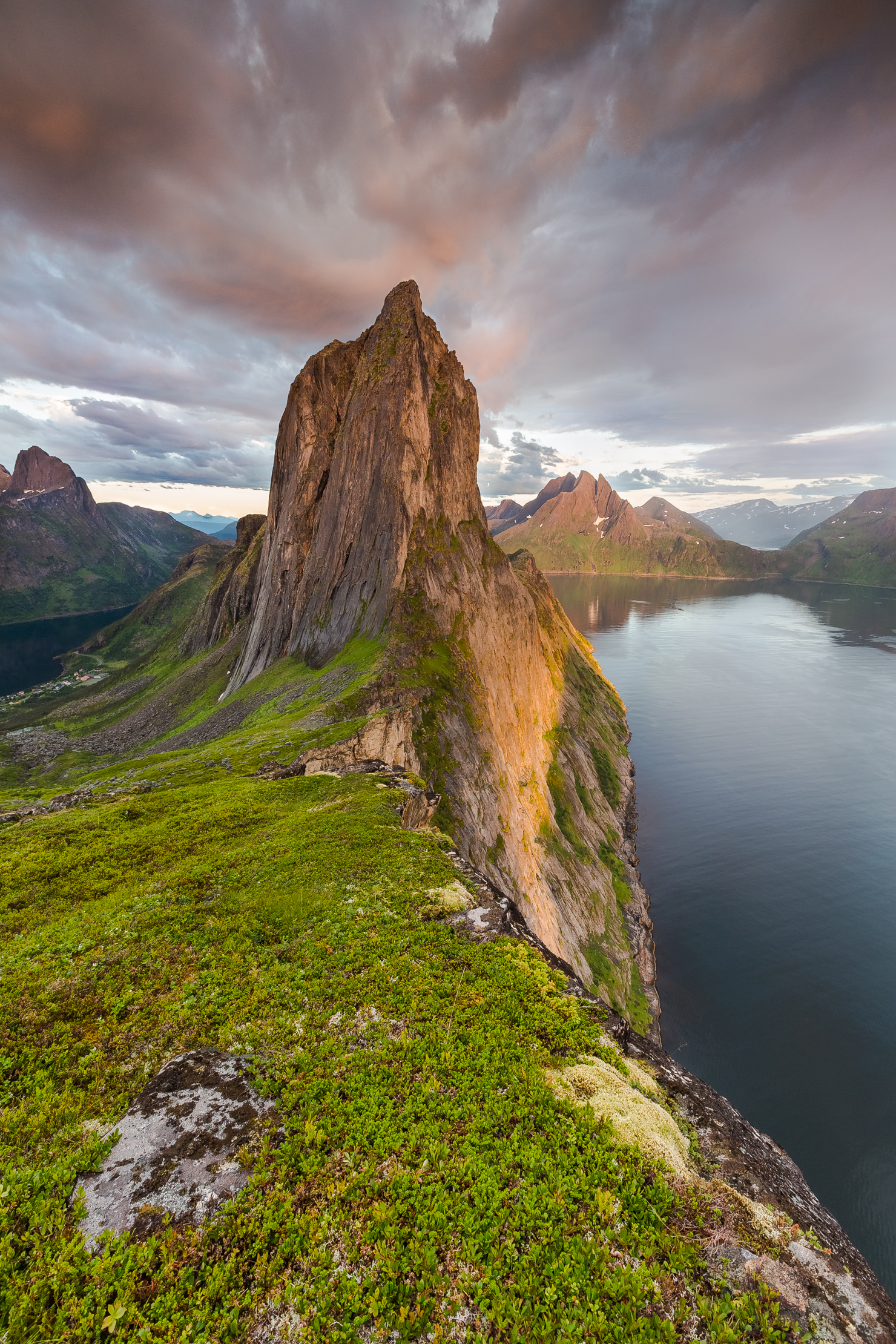 "Segla Mountain  - ""This is the most amazing mountain you can imagine, and my absolute favourite mountain at Senja Island - Troms. The heat of the day created these great rainy clouds with warm colours this early summer evening in July"""