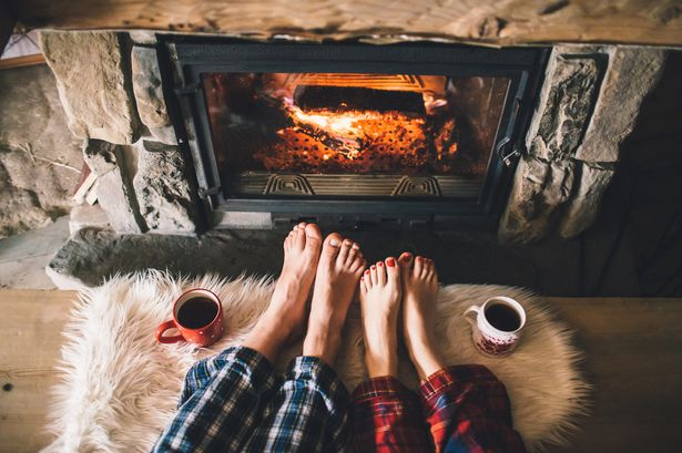 A warm, roaring fire and a mug of your favourite hot drink - perfect ingredients for finding hygge at home!  Image source
