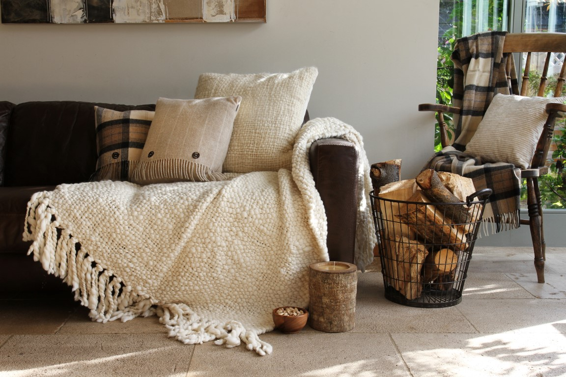These neutral yet still warm tones, and comfortable fabrics illustrate subtle examples of how you can bring a bit of hygge to your home.   Image source