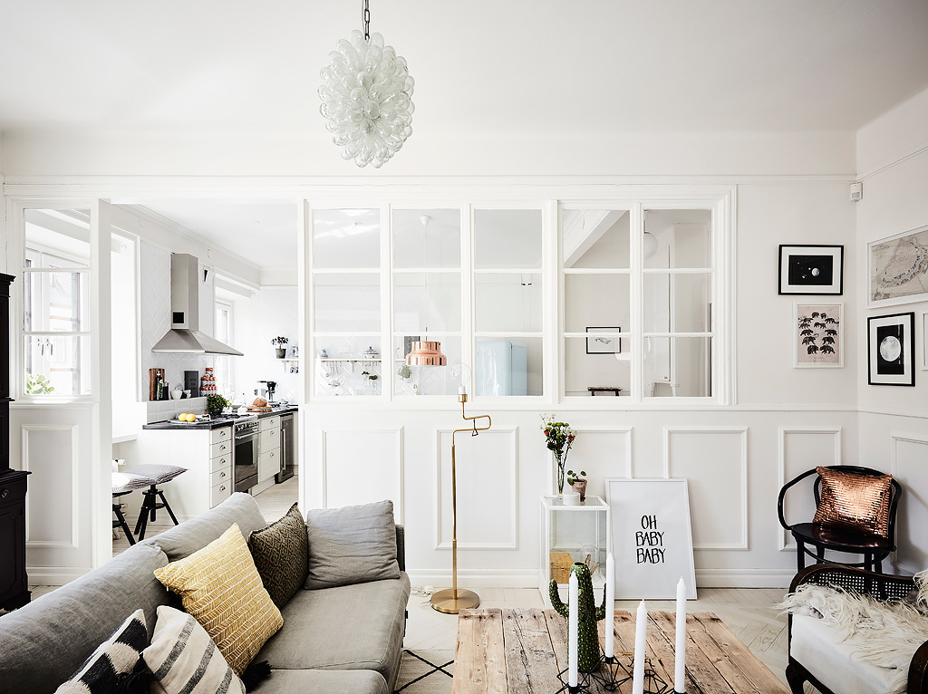 The natural light is beautifully accentuated by the open plan living style and white walls