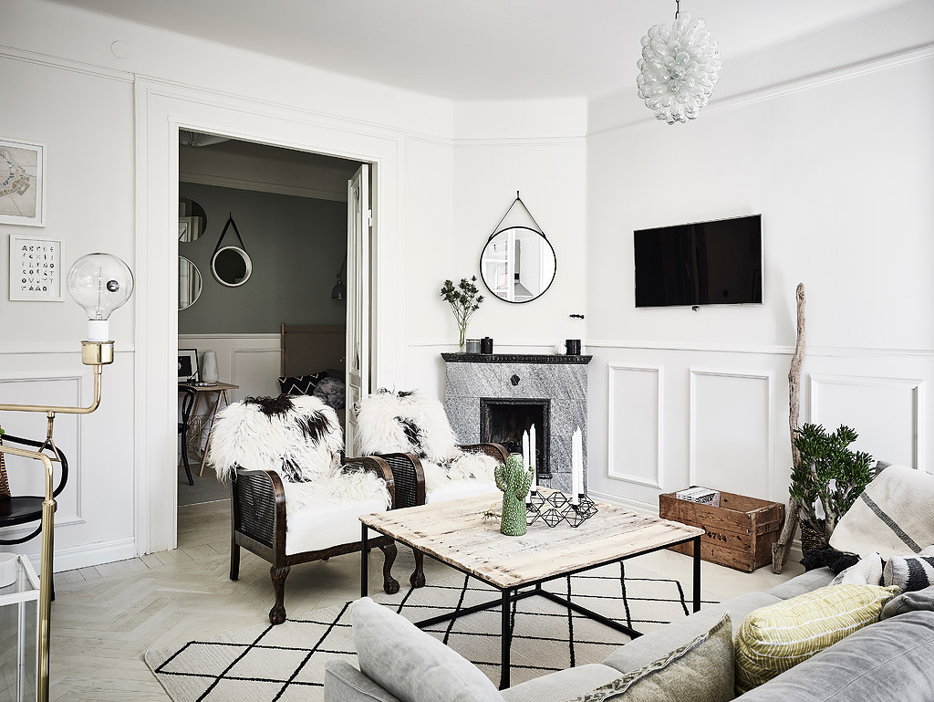 This industrial style coffee table with cosy cushions and furs really makes for a 'hygge' home.