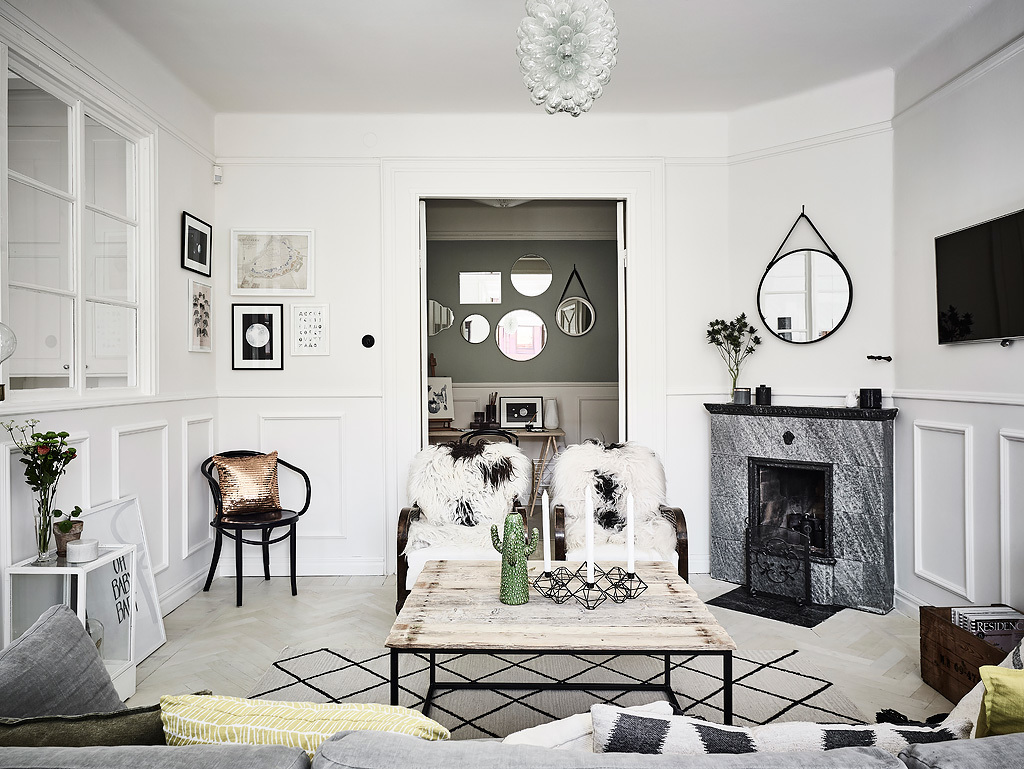 We love the cluster of mirrors on the far wall - an unusual but very effective feature
