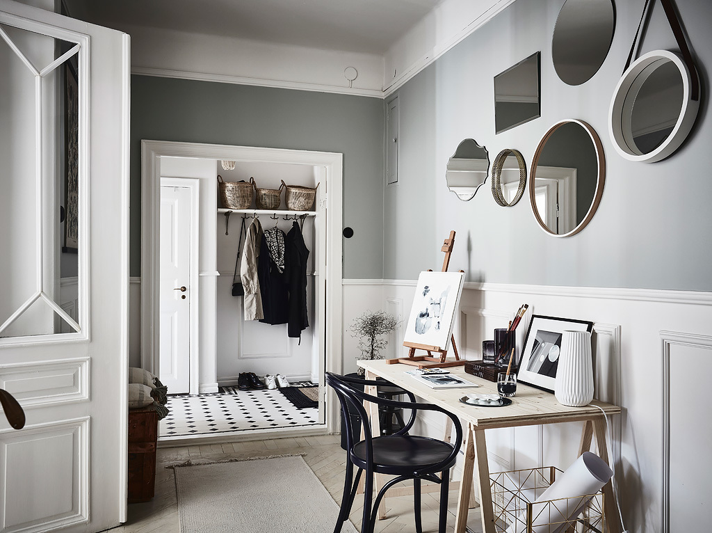 These powder grey walls offset beautifully with the white wooden floors and lightwood furniture
