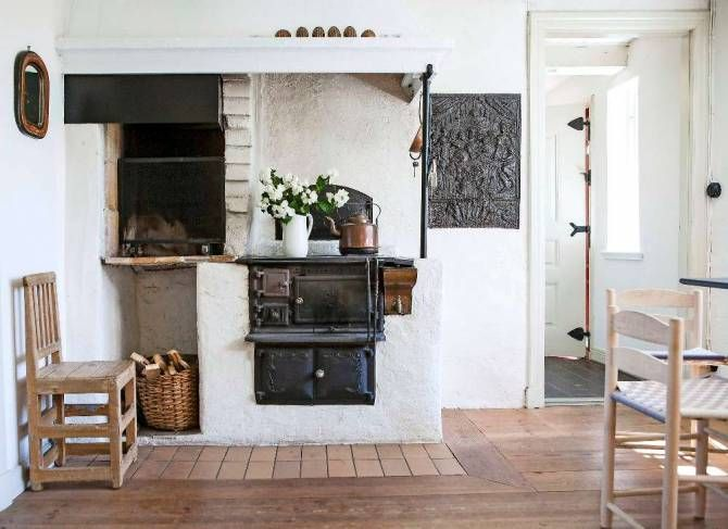 We love the rustic, cottage feel and unfussy style of this beautiful country home. We would certainly love to have an original oven like this in our home! Simple but cosy, with light wood furniture and minimal decor.     Image source