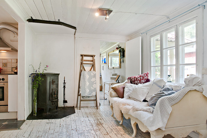 Gorgeous, sanded-down rustic floor boards.  For a relaxed country feel use lots of neutral coloured cushions, throws and blankets.     Image source