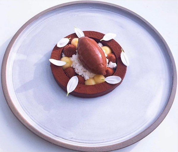 Chocolate ganache, chocolate sorbet, chocolate cremeux, browned butter snow and lemon cremeux