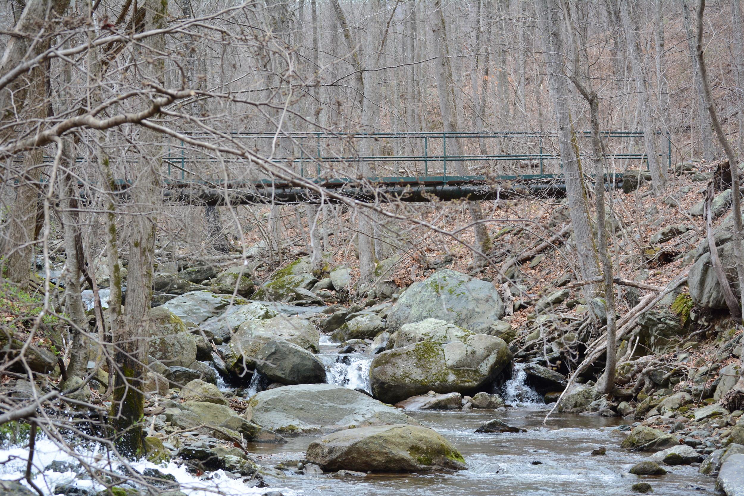 Steel footbridge leads to the start of the archery field.