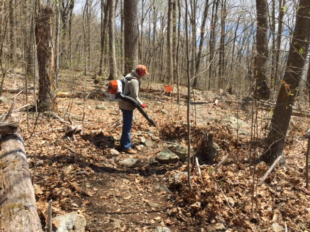 Keith Smith (above) and Ron Cote' high-powered leaf blowers recovered the trail.