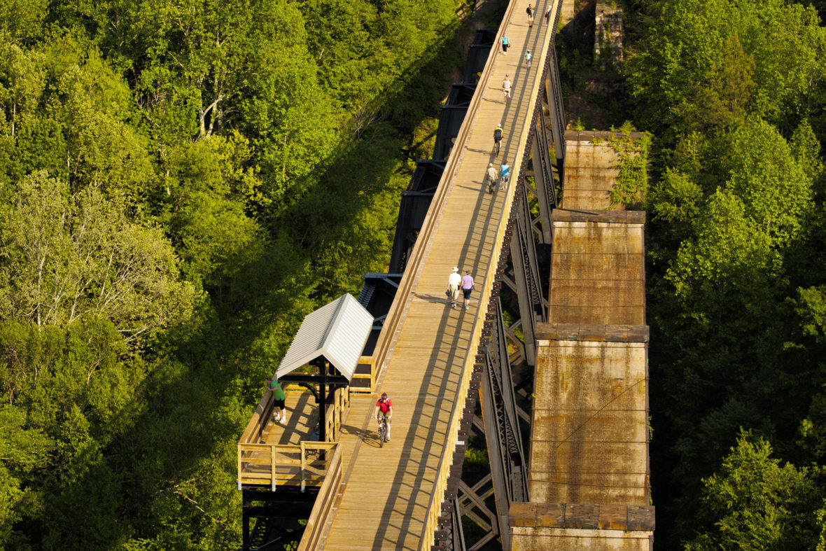 High Bridge Trail  is 31 miles long and ideally suited for hiking, bicycling and horseback riding. Once a rail bed, the trail is wide, level and generally flat. Its finely crushed limestone surface and dimensions make it easy to enjoy. The park's centerpiece is the majestic High Bridge, which is more than 2,400 feet long and 125 feet above the Appomattox River. It is the longest recreational bridge in Virginia and among the longest in the United States. High Bridge, a Virginia Historic Landmark, is on the National Register of Historic Places. The trail is a National Recreation Trail recognizing exemplary trails of local and regional significance, connecting people to nature, to each other, and to our shared history and culture. Bring drinking water because none is available on the trail.