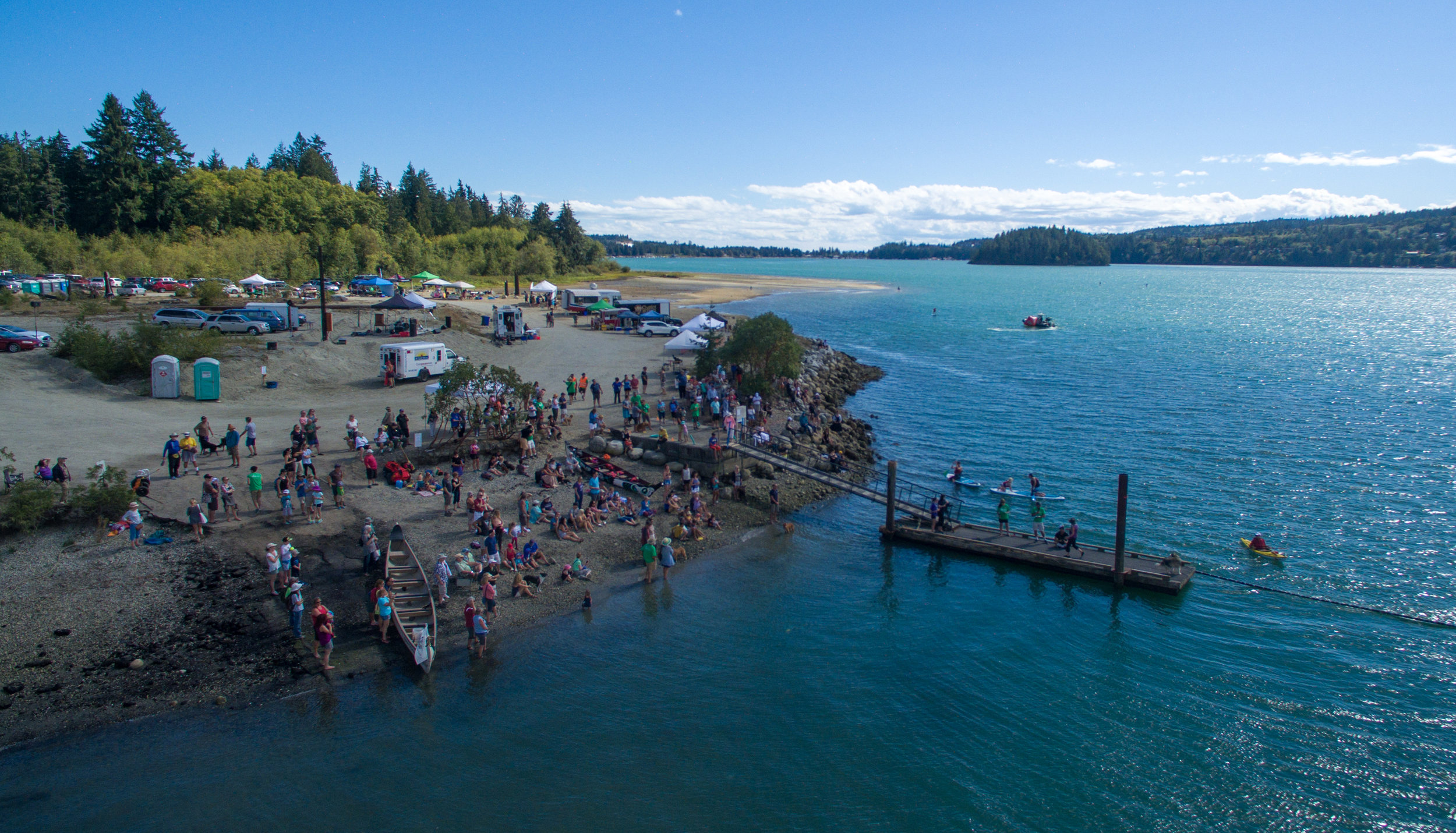 Spectators enjoy a sunny day on the beach while watching the Dog Dock Diving Contest.
