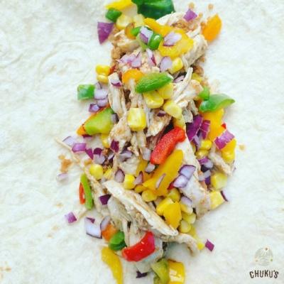 Our honey suya chicken Eko Burrito - The Alade