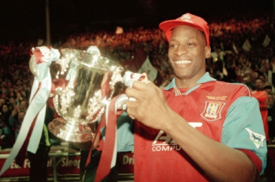 Ugo Ehiogu with the League Cup Final trophy after Aston Villa beat Leeds in 1996 (credit: Getty Images)
