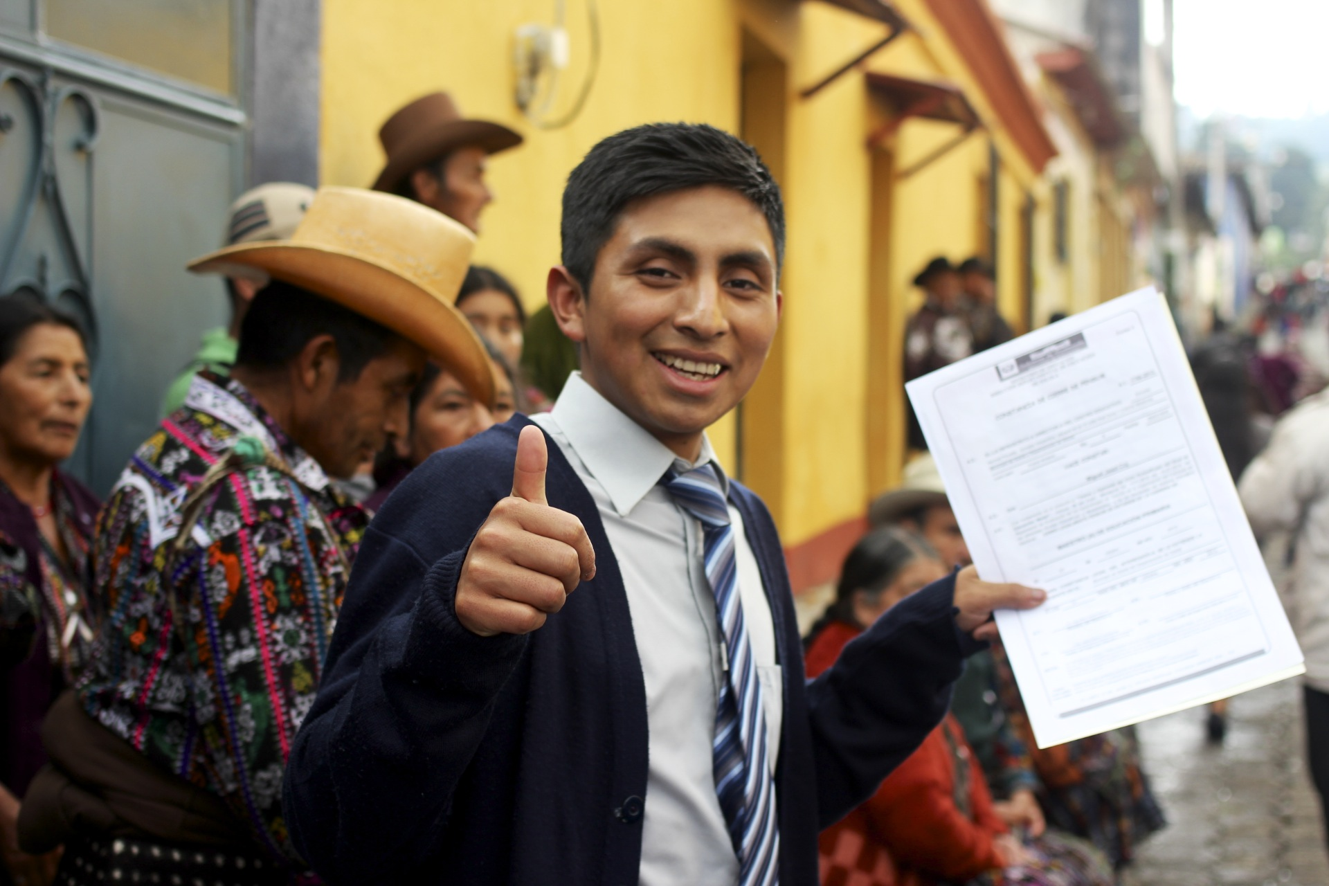 Miguel Jeatz Coj, on the day of his high school graduation in Solola, celebrating with his family.