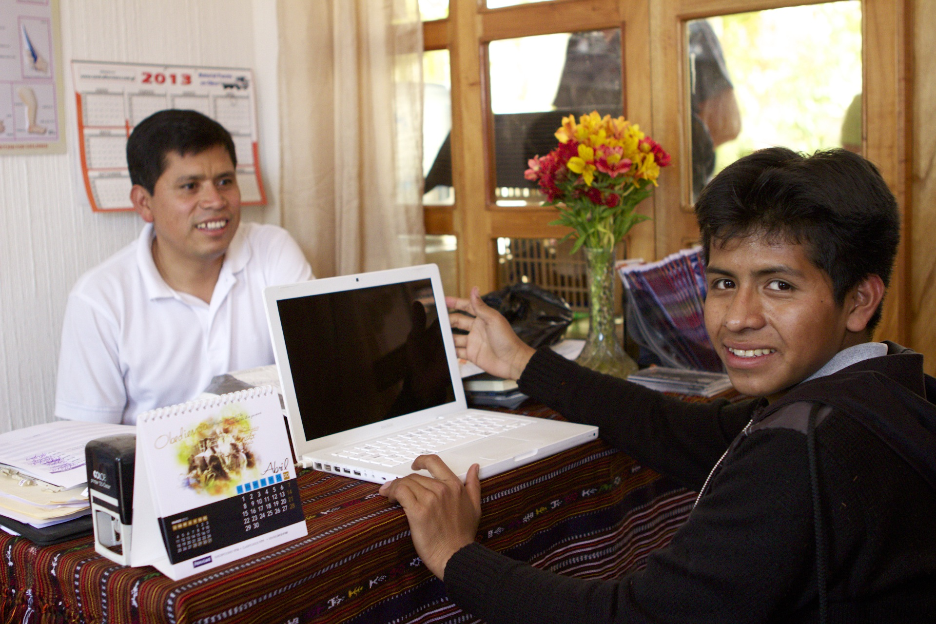 Gregorio with student Juan Antonio, who has become a computer expert in repair and networking, hosting a mini-internet-cafe in his home, and now studying systems engineering in university.  Before the scholarship, he had never touched a computer.