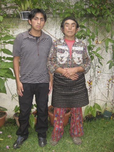 Miguel and his father German, on the day he received the scholarship in 2011, with his best non-smiling stoic face for his formal photo.