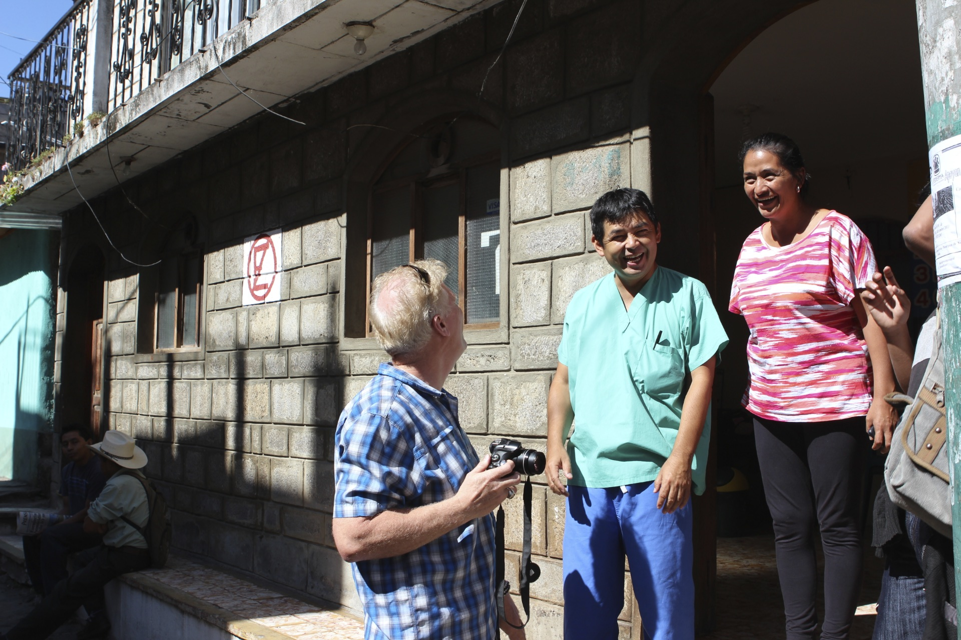 Tim with Francisco and Carina, in the front door of Francisco's childhood home, which has now become his current medical clinic.