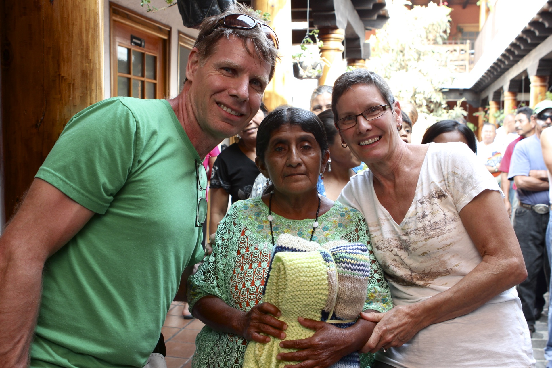 Orville and Grace with one of the blanket recipients at Casa De Fe in Antigua, where Conexions brings knitted blankets.  The recipients are patients at a local hospice, waiting for or recovering from surgeries, and blankets make the experience a little better.  Some have traveled ten hours to receive a surgery.