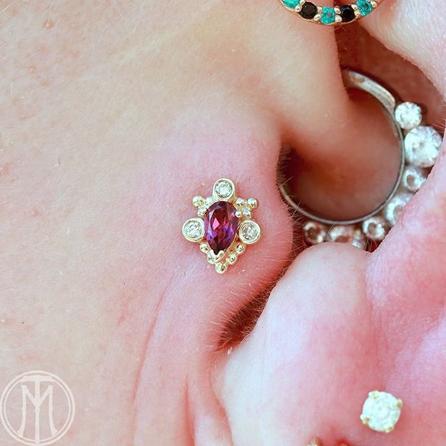 Healed tragus on Lisa we upgraded to this gorgeous Pear Helana. AA Rhodolite center surrounded by Champagne Diamonds.  Thanks for looking!  Jewelry from @bvla . . .. ... .. . . #modify #modifytattoo #modifytattoomn #piercing #piercings #bodypiercing #bodypiercings #bodyjewelry #earpiercing #cartilagepiercing #tragus #traguspiercing #legitjewelry #gold #goldjewelry #bvla #bodyvision #bvlalove #girlswithpiercings #piercingideas #gratitude #grateful