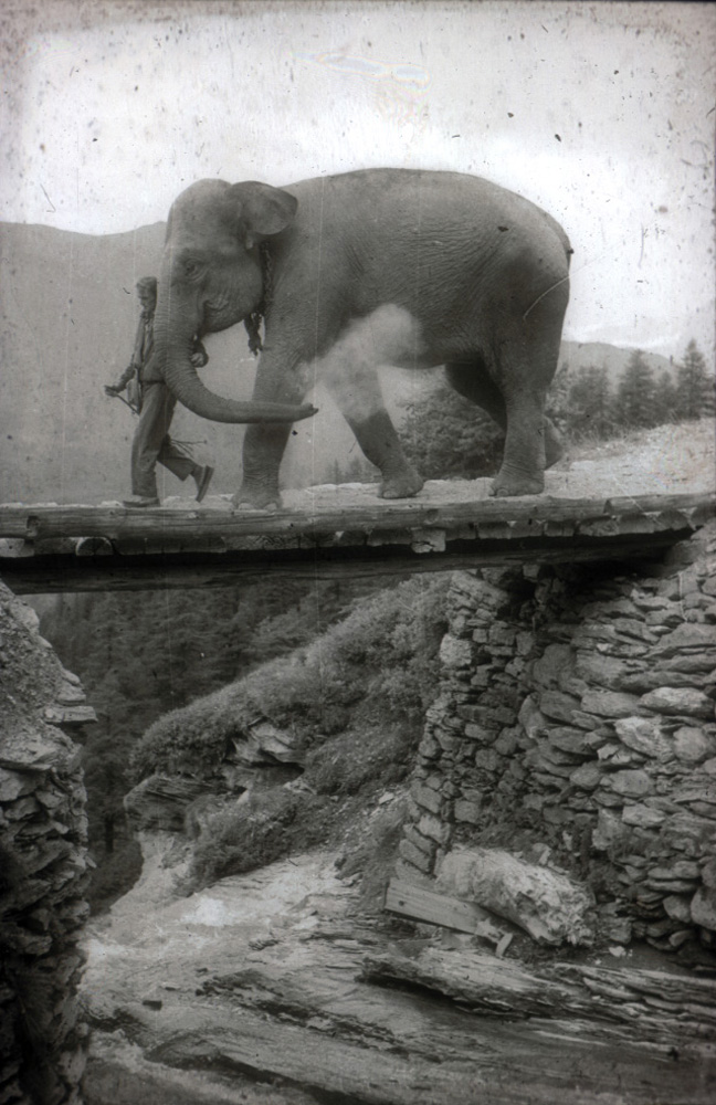 Crossing a high mountain bridge.