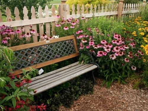 Benches are classic garden seating but awkward for conversation. — vikram/CC