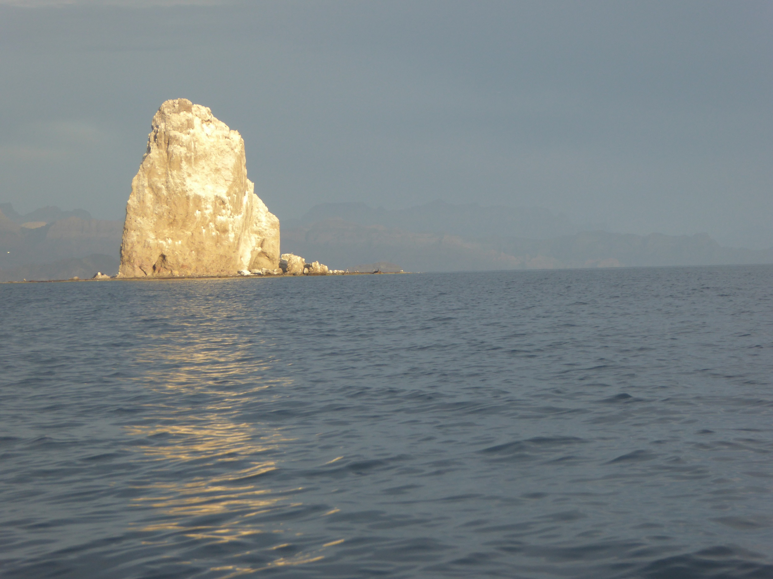 Sun on the rock that indicates entrance to Aqua Verde