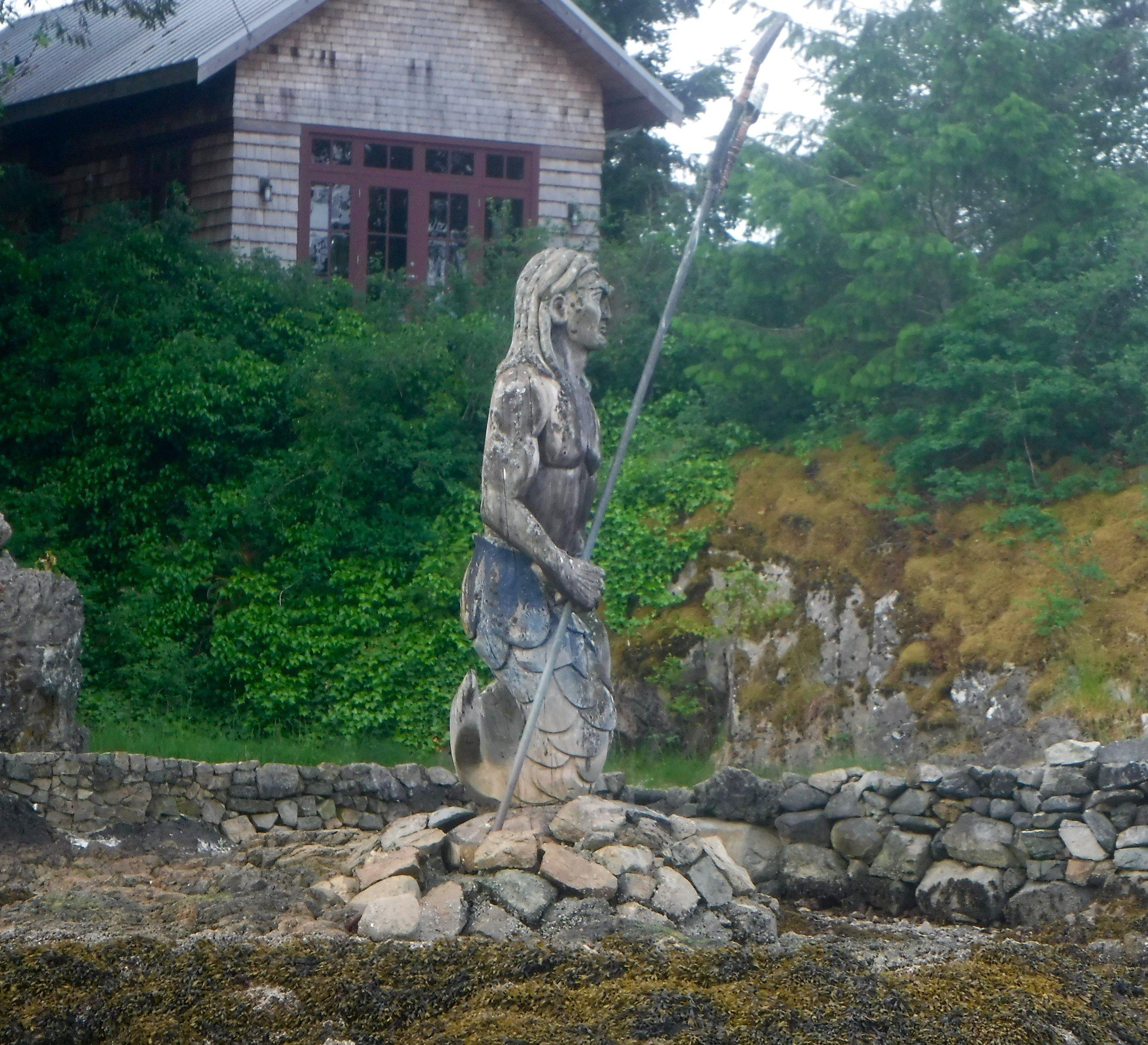 a mermaid statue