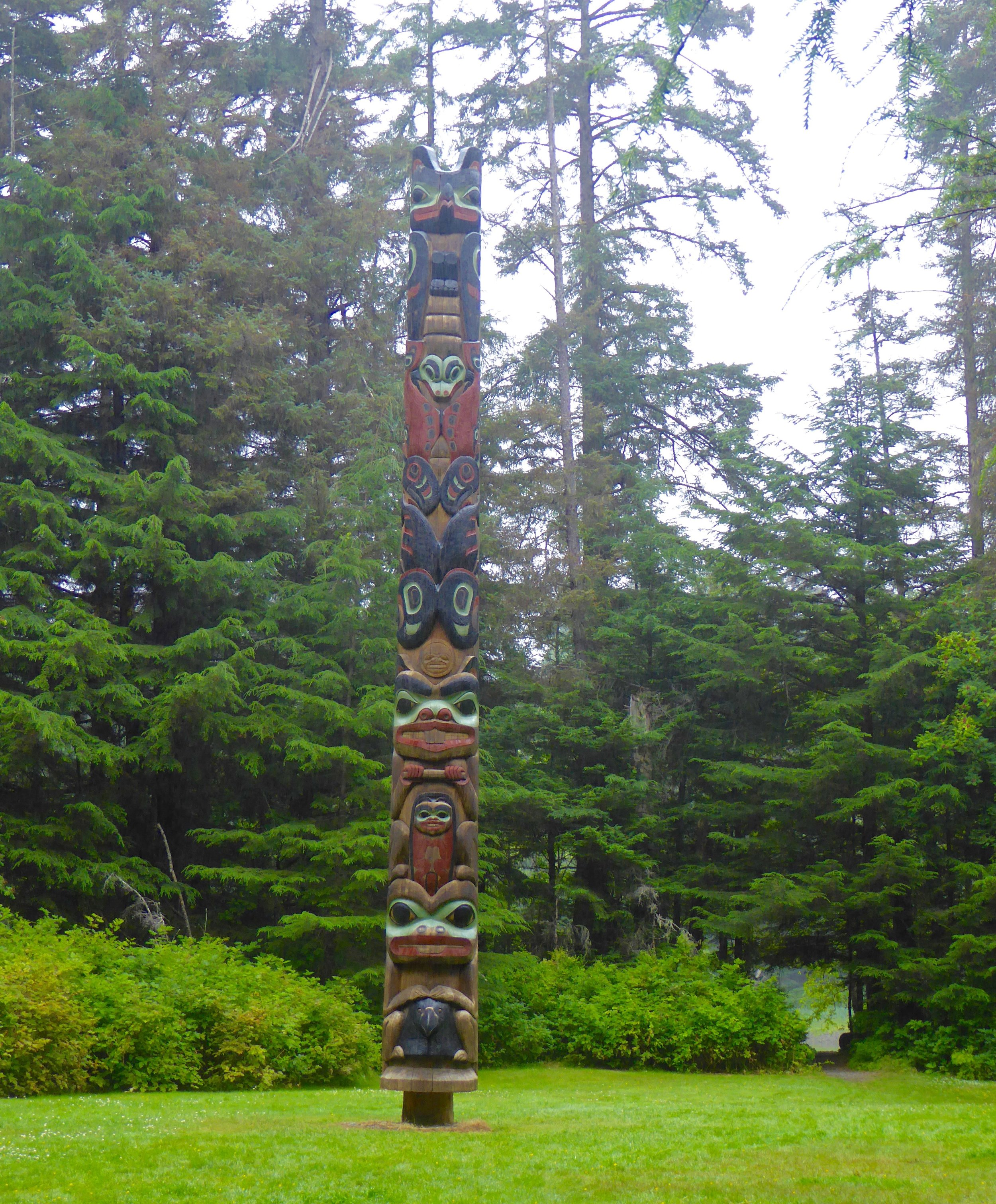 Many totem poles were displayed thru out the forest.