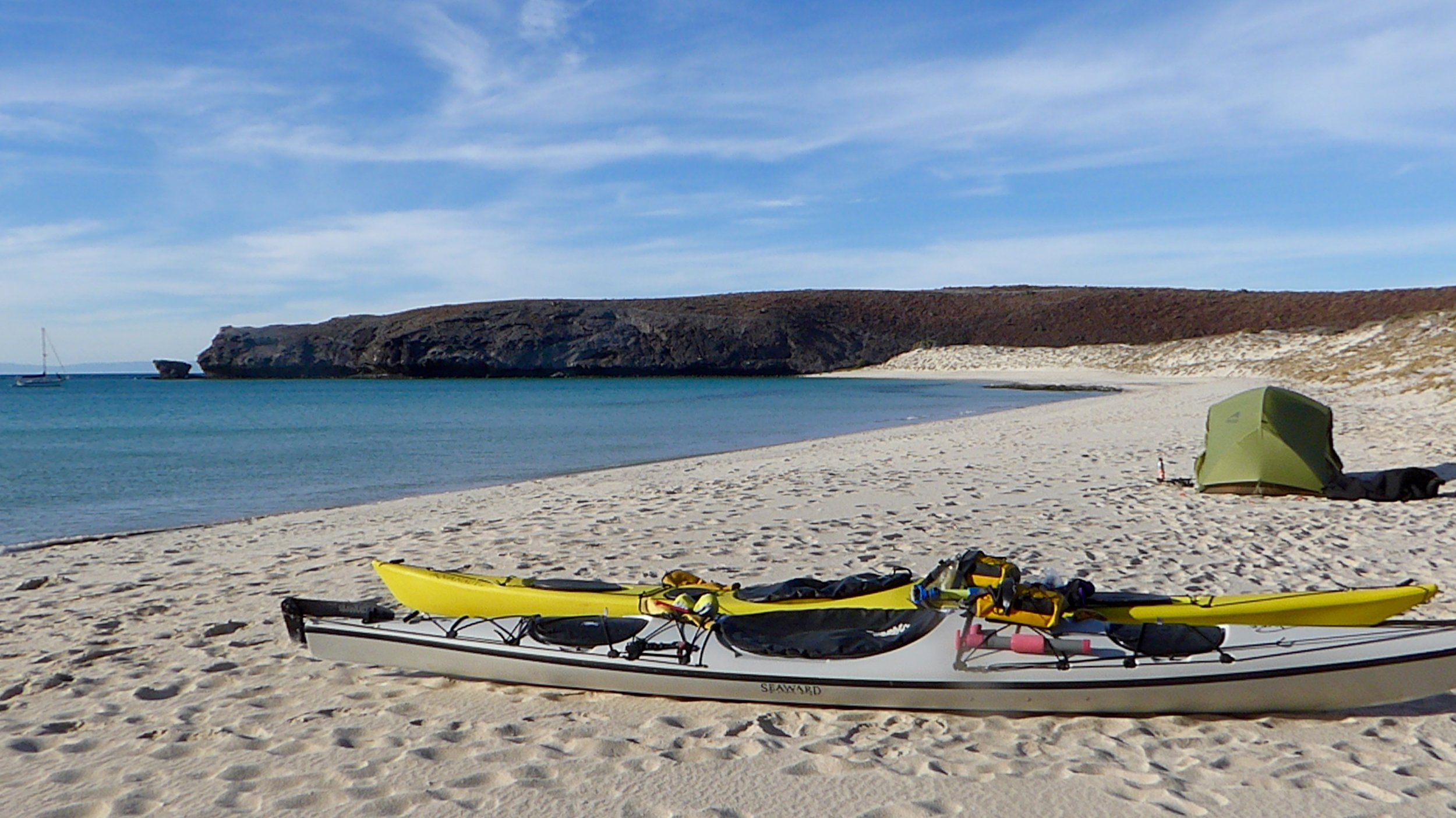 We generally do not like camping on sand, but this was the preferred option instead of beating against the wind.