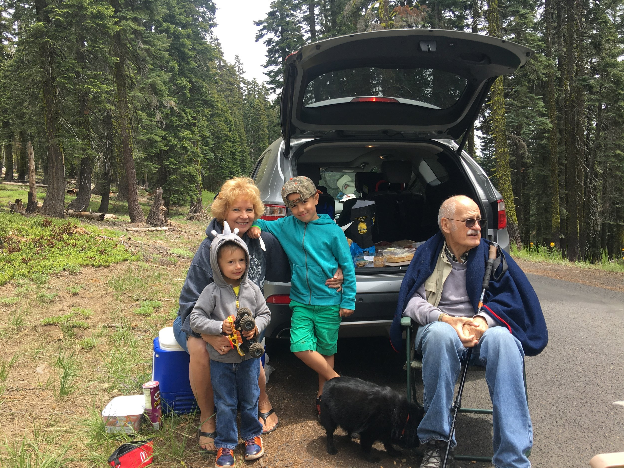 This couple whose son is hiking the trail this year had brought their grandsons to this trailhead in hopes of seeing some hikers. In their car was soda, chips, fruit and warm banana bread. They plan on returning here over the 4th of July and cooking breakfast for any hikers who are passing thru.