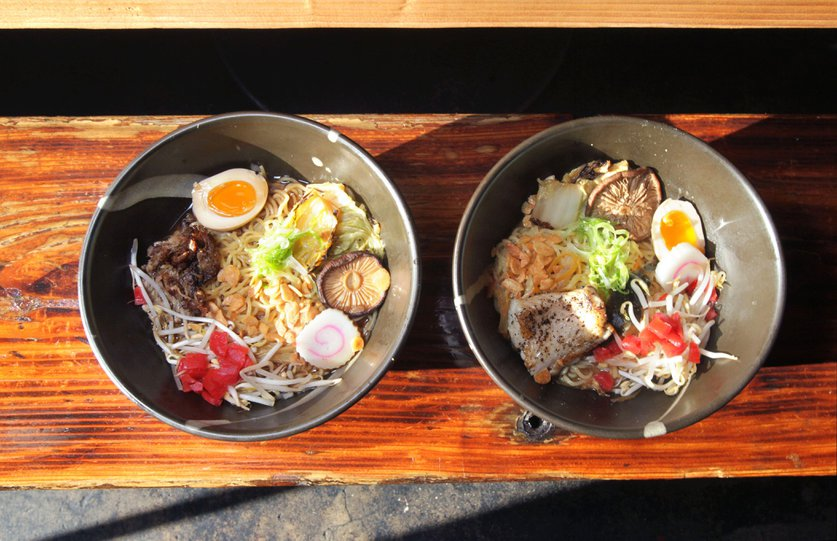 Detail view of two ramen noodle dishes at The Whet Noodle. At left is Duck Shoyu and at right is Hot and Sour Miso, both with added egg.  San Diego Union-Tribune