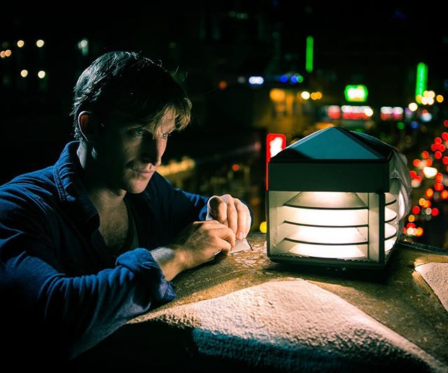 Derik Hultquist, a mightily talented recording artist, songwriter, and unsung hero of Instagram, ponders a lamp on the pedestrian bridge spanning the Cumberland River in downtown Nashville. The traffic you see below in this photo is no joke. I got stuck in it after we wrapped this shoot and, after going less than a block in two hours, I ran out of gas. Derik was brave enough to launch a rescue mission to extract me, venturing deep into the mean streets of Trashville on foot, armed with nothing more than a half-empty gas can. A true soldier. @derik_hultquist #NashVegas #citylights @natgeocreative