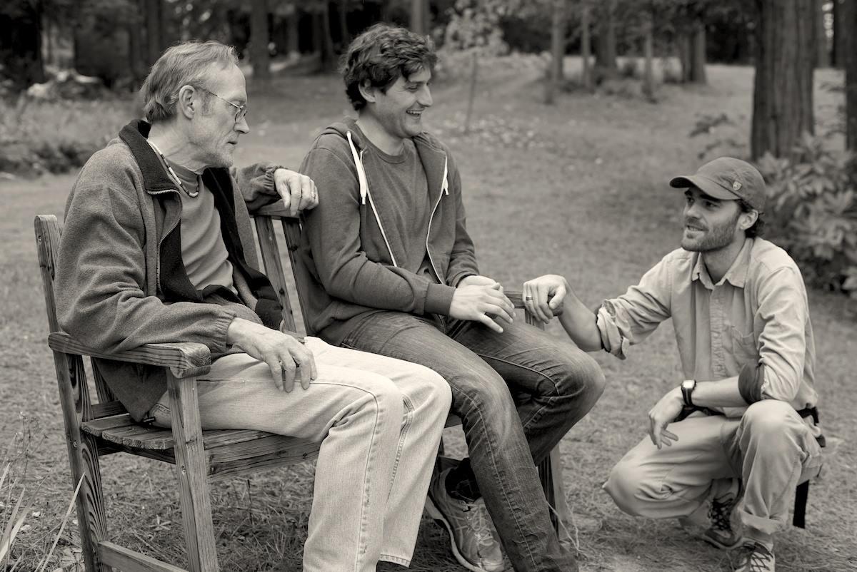 Actors James Carpenter, Josh Schell, and writer/director Eric Daniel Metzgar on set.