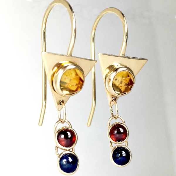 14k gold with rose-cut citrine, garnet, and blue sapphire. Design inspired by the flag of the Philippines.