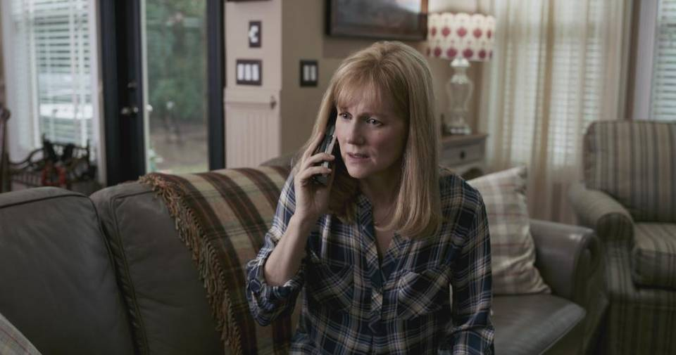 "Laura Linney on the phone in ""Sully."" Photo courtesy: Warner Bros."