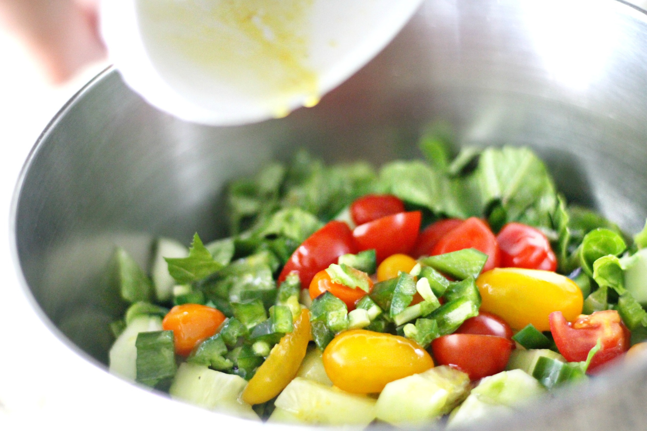 Pour in the whisked dressing into the salad bowl. Toss + mix it! I like my salads a bit over dressed so pour it in little by little to best suit you.