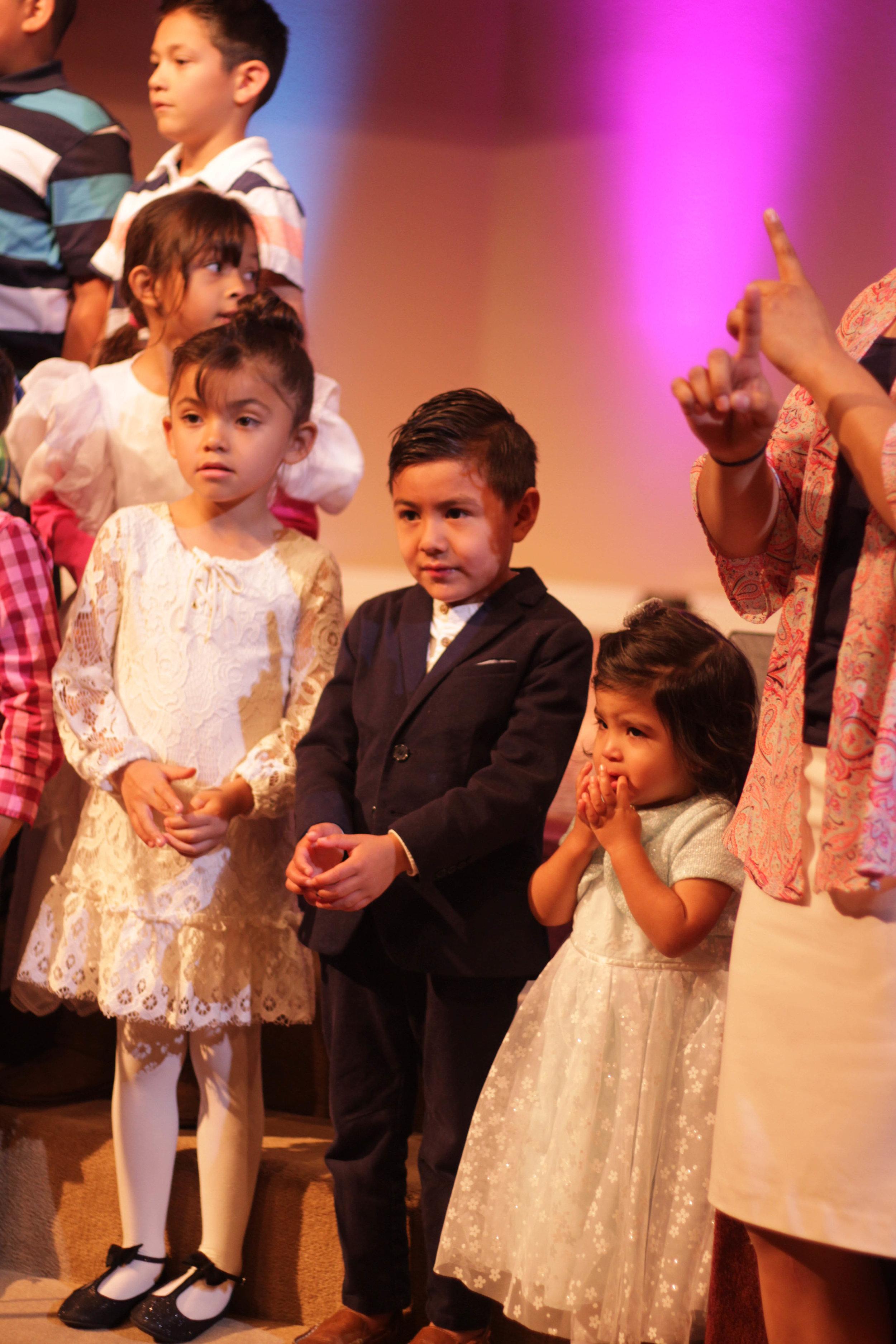 Judah singing with his church kids choir