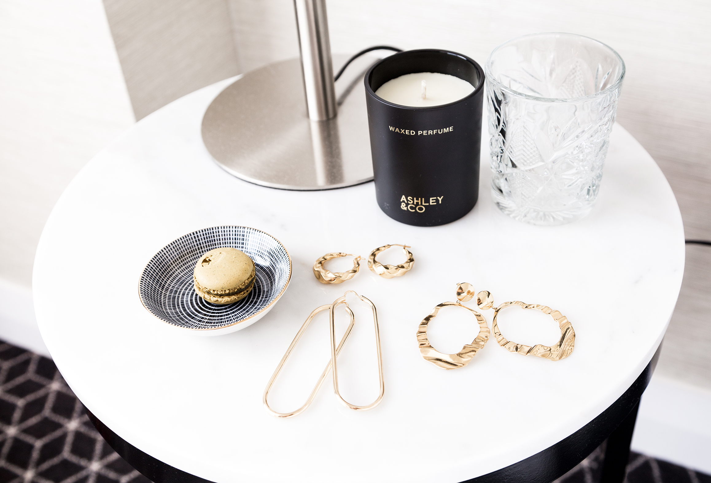 Crystalware and surprise snacks left by housekeeping. Textured earrings by  Flash  releasing October, elongated hoops by Jasmin Sparrow coming to  Maker's Mrkt