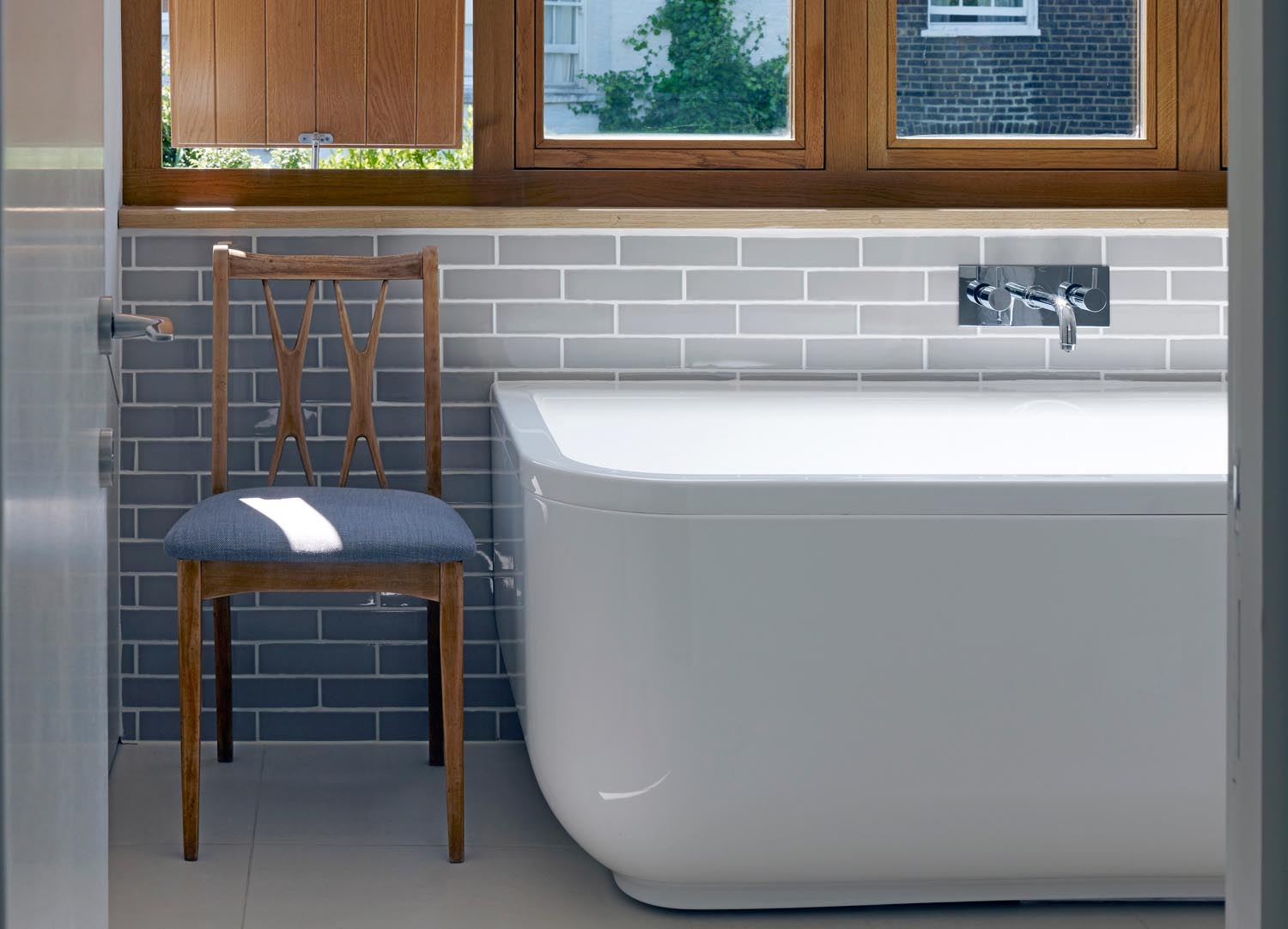 Jill Scholes Interior design, mews house, master bathroom detail with bath and view to window
