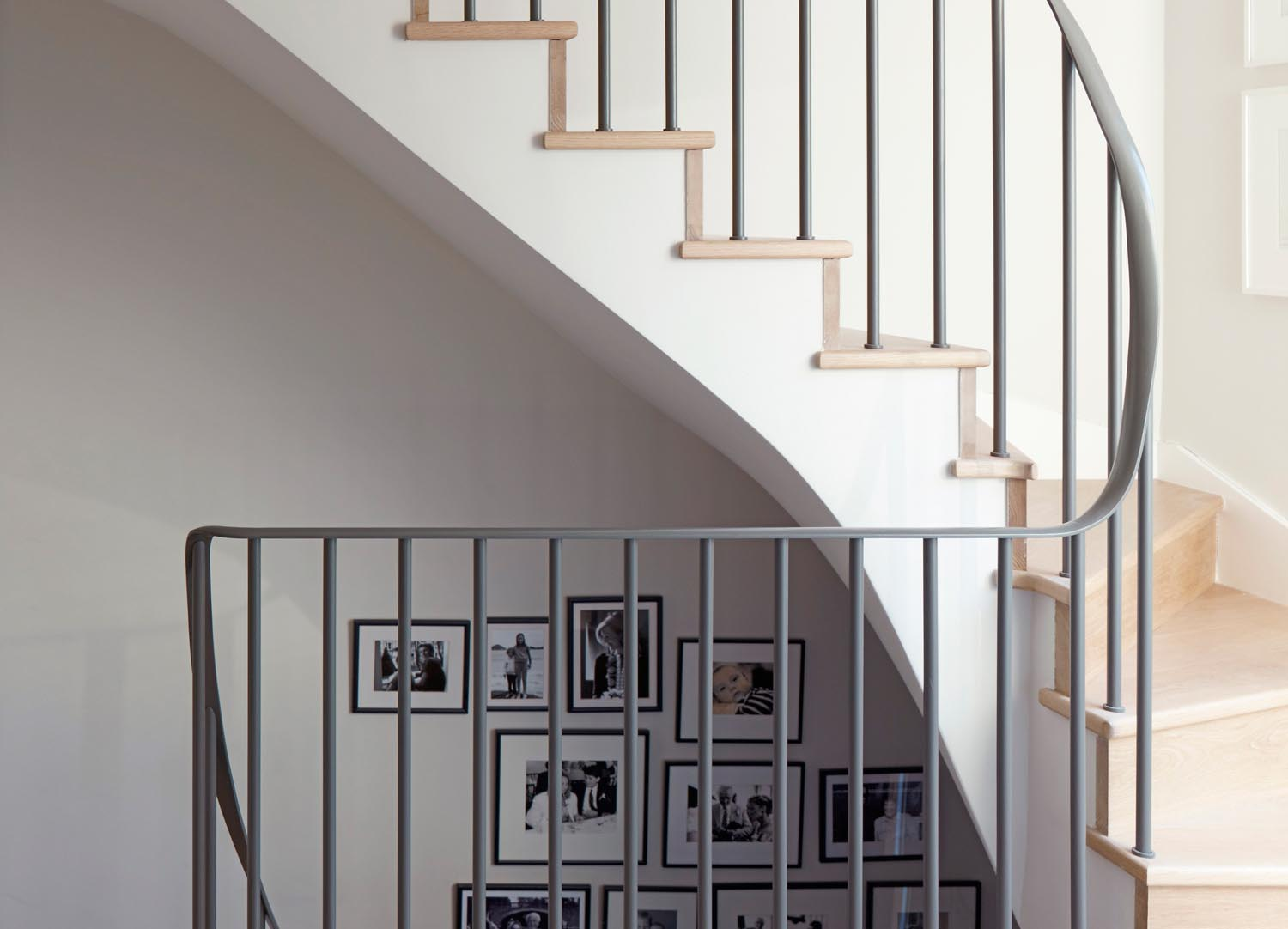 Jill Scholes Interior design, mews house, staircase with metal balustrade and family photo gallery