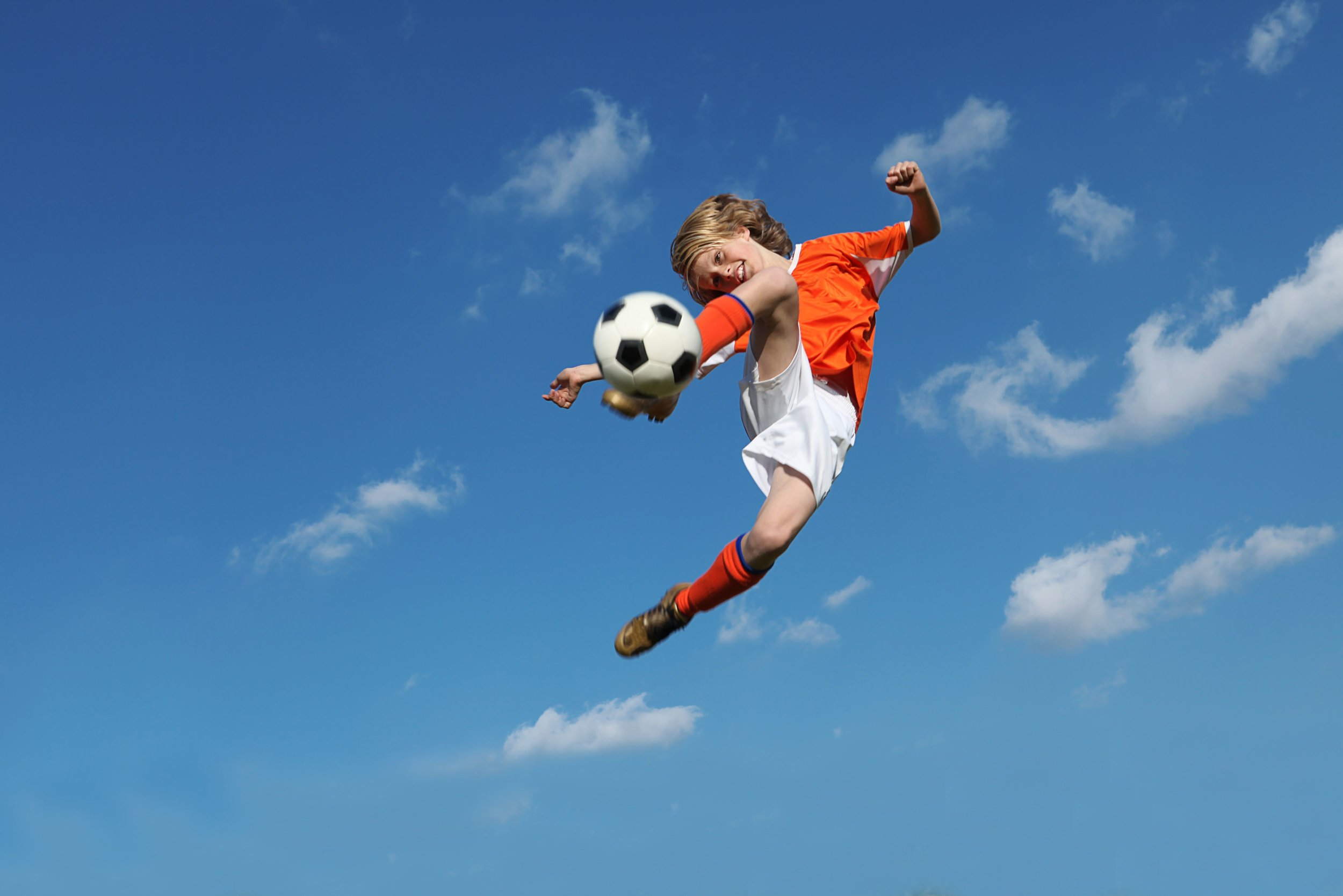 kid-kicking-soccer-in-air.jpg