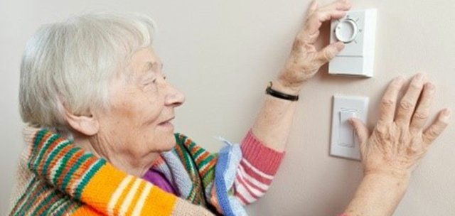 adjusting-thermostat.jpg