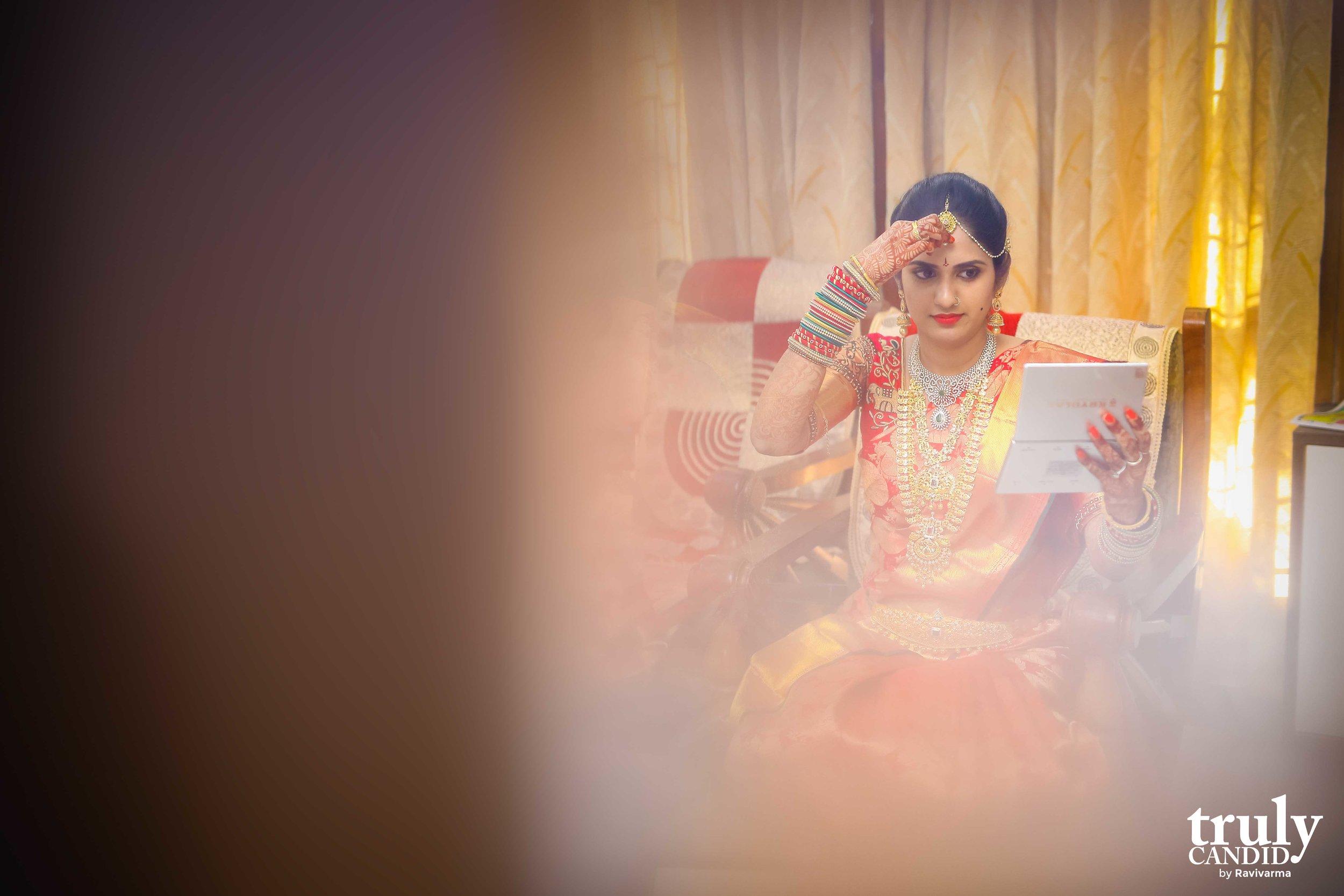 Indian Bride applying makeup