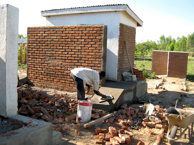 12 Nsuka Primary school Head teacher(a Mr Mmadi) appreciating the completed works.JPG