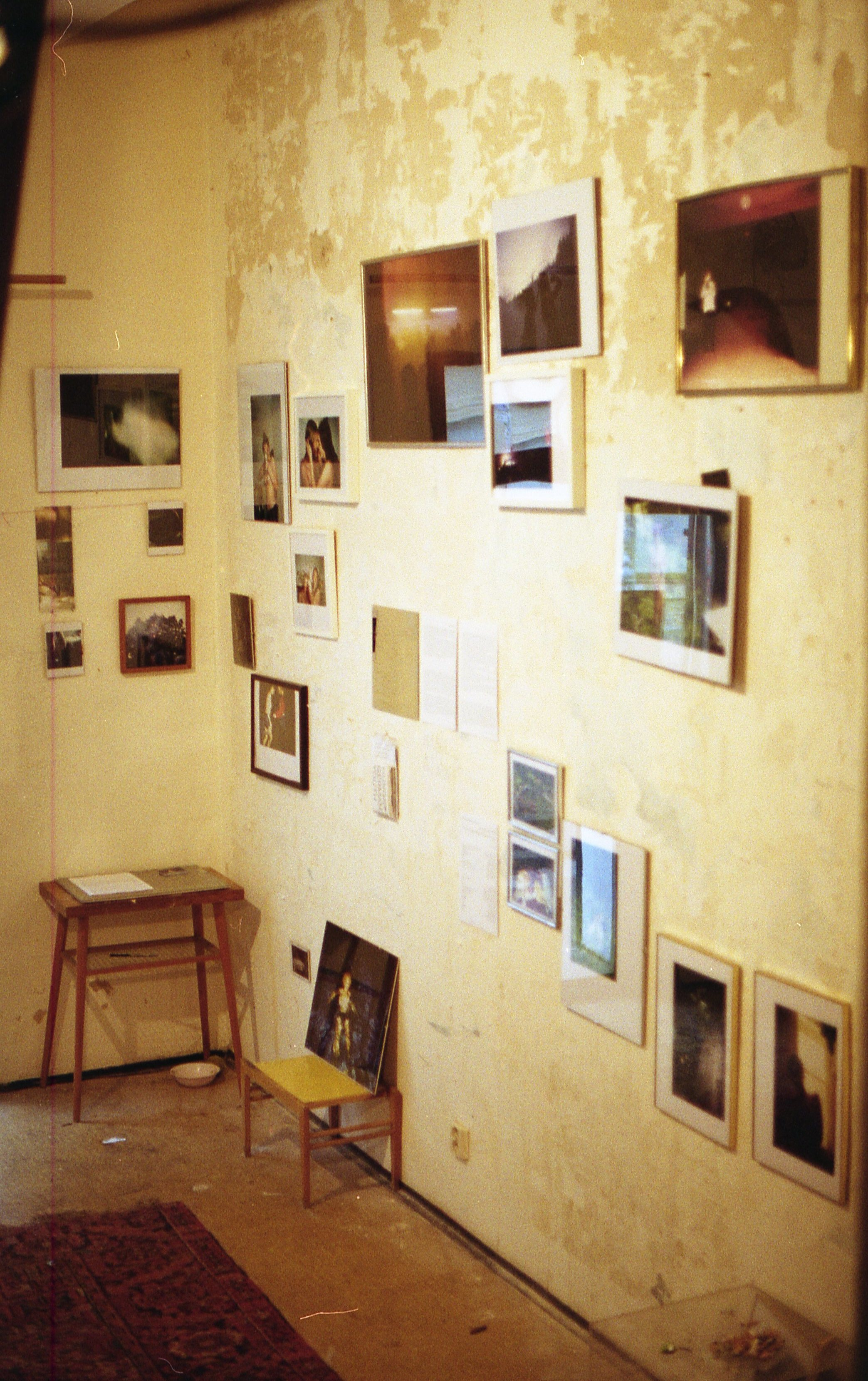 space reflecting in the photographs on the wall.jpg