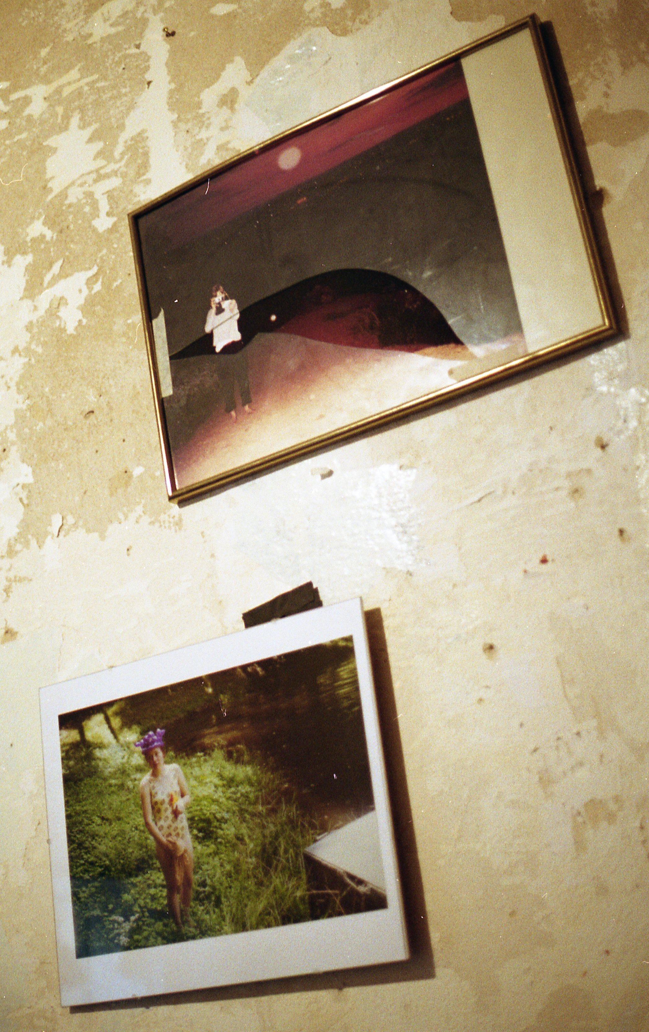 shetterd frame on tattered wall cointaining 'ida, ostrava' and 'frantiska, mariz'.jpg