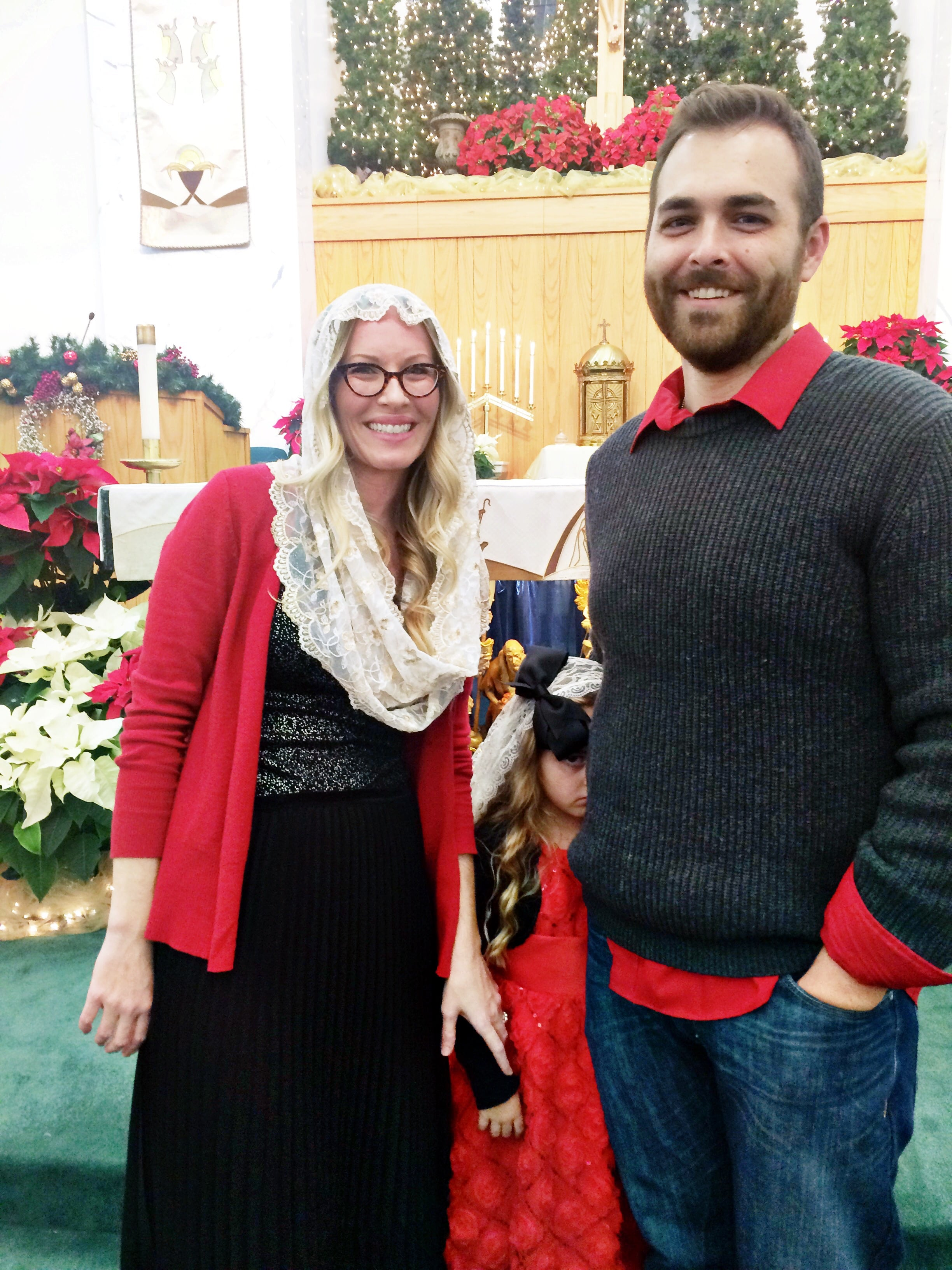Family pic after Midnight Mass, with a very cranky Chloe.