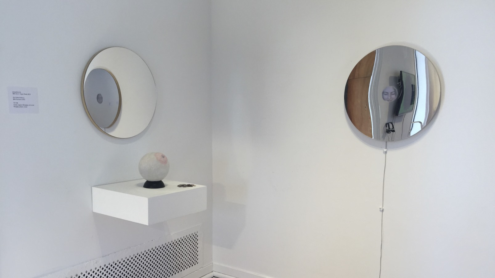 Tit Me    Fiberglass, Gouache, Mirrorred plexiglass, Sculpey, Soccerball coin bank, Video loop, Wood   April 2015
