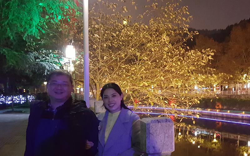Ms. Yao and her husband next to the Xiangjiang River in Zunyi