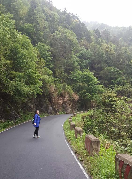 Xie Xiaoyan takes her morning stroll near her village in the mountains.